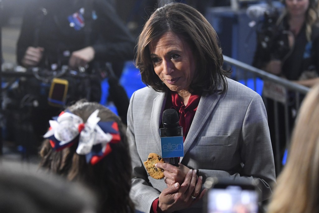 FILE - In this Nov. 21, 2019, file photo, then-Democratic presidential candidate Sen. Kamala Harris, D-Calif., listens to a question in the spin room ...