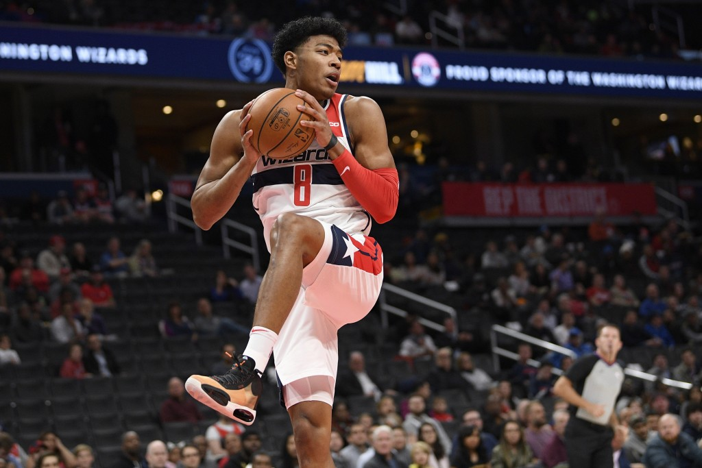 Washington Wizards forward Rui Hachimura (8), of Japan, grabs the rebound during the first half of an NBA basketball game against the Orlando Magic, T...