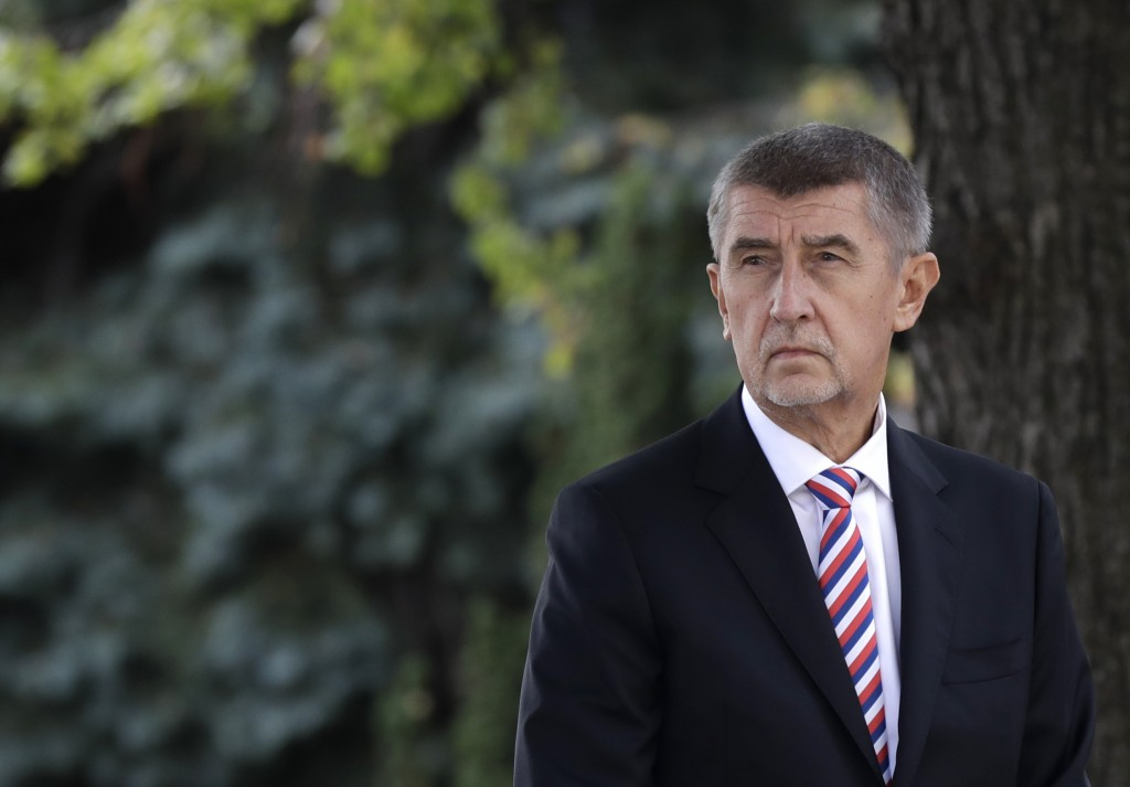 FILE - In this Oct. 26, 2018 file photo Czech Republic's Prime Minister Andrej Babis waits in front of his residency in Prague, Czech Republic. On Wed...