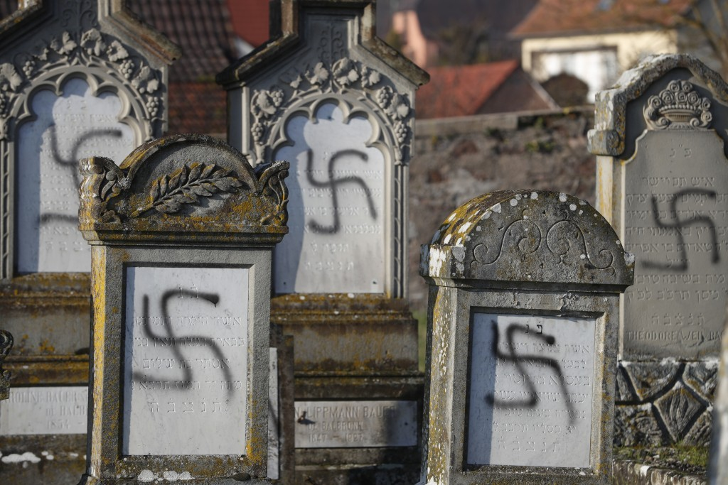 Vandalized tombs are pictured in the Jewish cemetery of Westhoffen, west of the city of Strasbourg, eastern France, are pictured Wednesday, Dec. 4, 20...