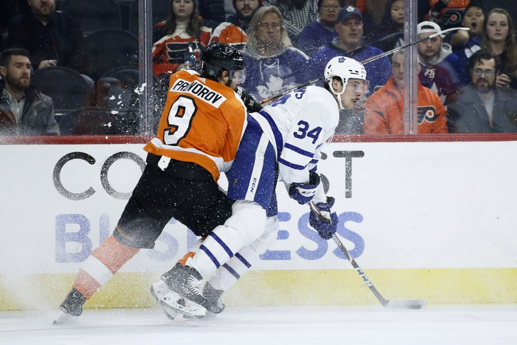 Toronto Maple Leafs' Auston Matthews (34) tries to keep Philadelphia Flyers' Ivan Provorov (9) away from the puck during the first period of an NHL ho...