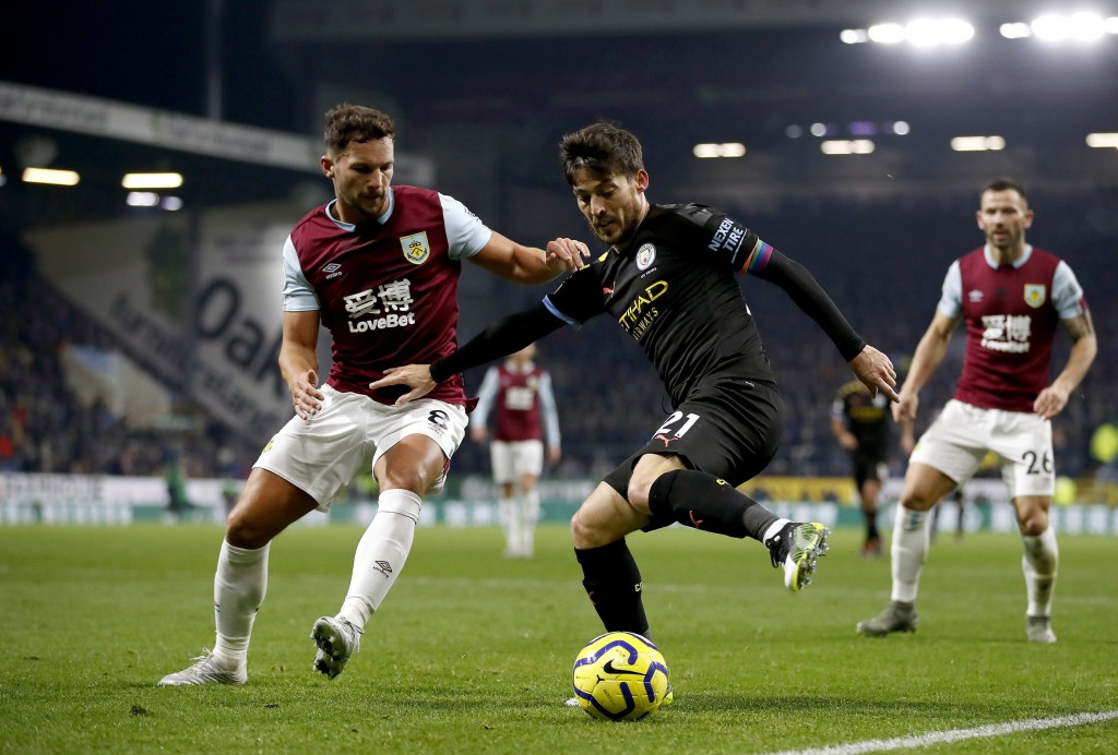 Burnley's Danny Drinkwater, left, and Manchester City's David Silva in action during their Premier League soccer match at Turf Moor in Burnley, Englan...