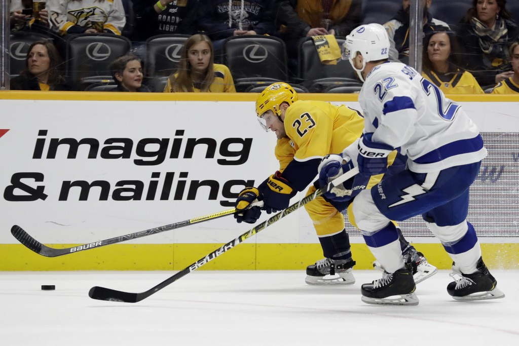 Nashville Predators right wing Rocco Grimaldi (23) moves the puck against Tampa Bay Lightning defenseman Kevin Shattenkirk (22) in the second period o...