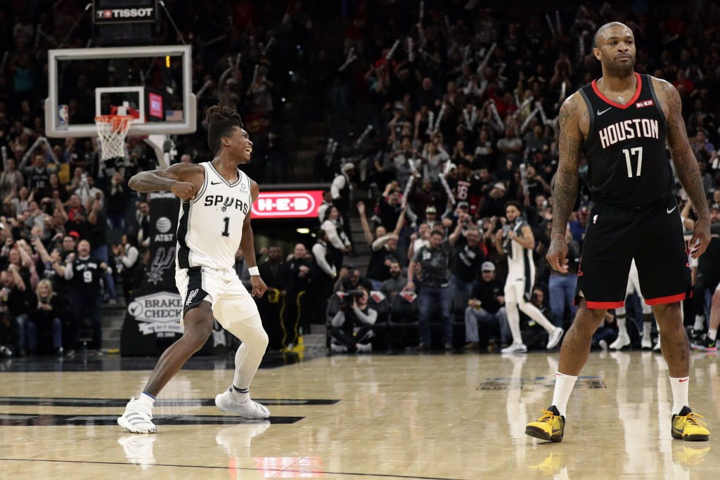 San Antonio Spurs guard Lonnie Walker IV (1) reacts after scoring to tie the score in the final seconds of the second half of an NBA basketball game a...