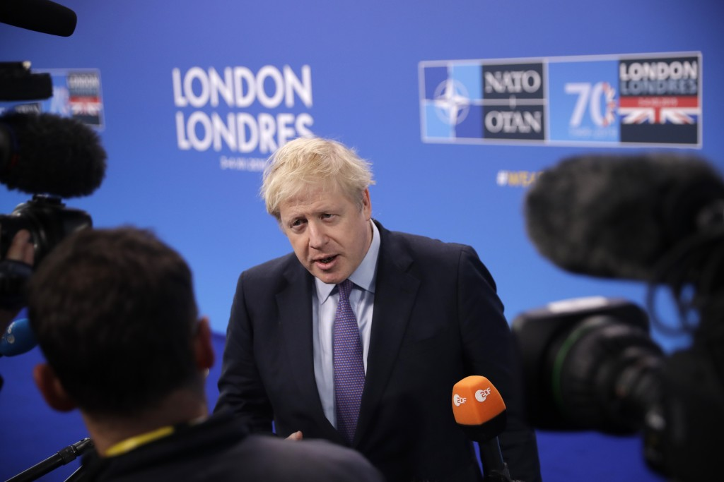 British Prime Minister Boris Johnson arrives for a NATO leaders meeting at The Grove hotel and resort in Watford, Hertfordshire, England, Wednesday, D...