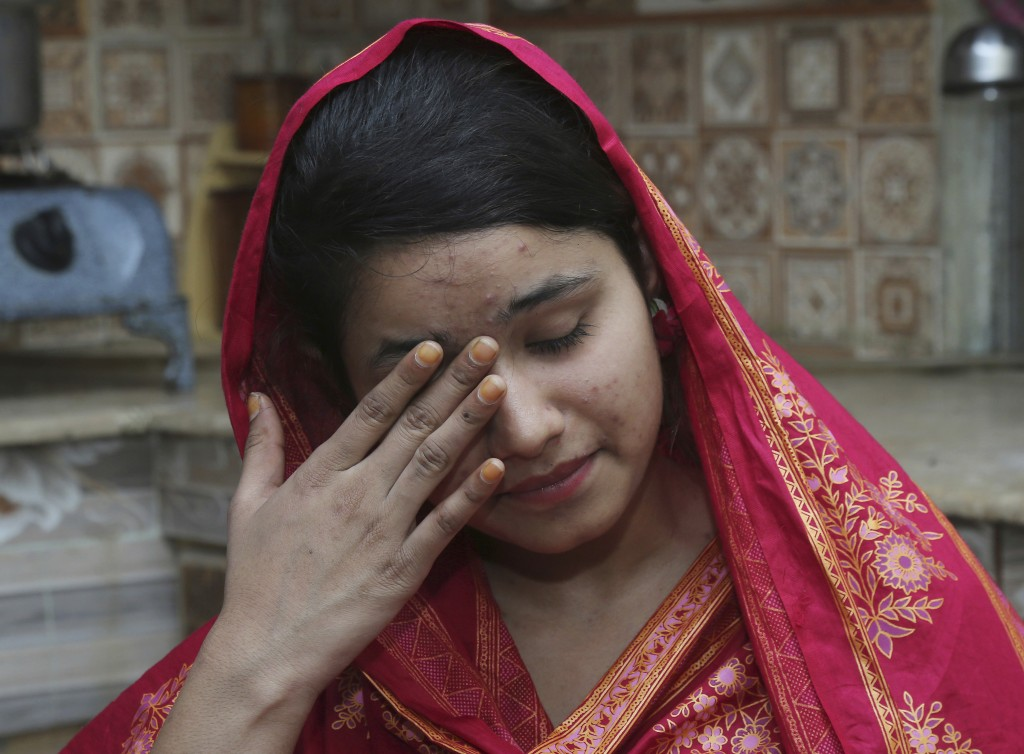 FILE - In this April 14, 2019 file photo, Pakistani Christian Mahek Liaqat, who married a Chinese national, cries as she narrates her ordeal, in Gujra...