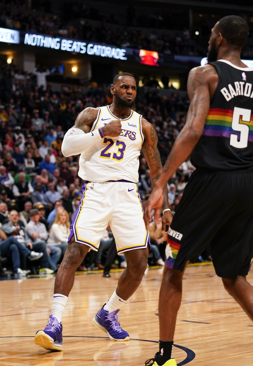Los Angeles Lakers forward LeBron James reacts to a dunk against the Denver Nuggets during the first quarter an NBA basketball game Tuesday, Dec. 3, 2...