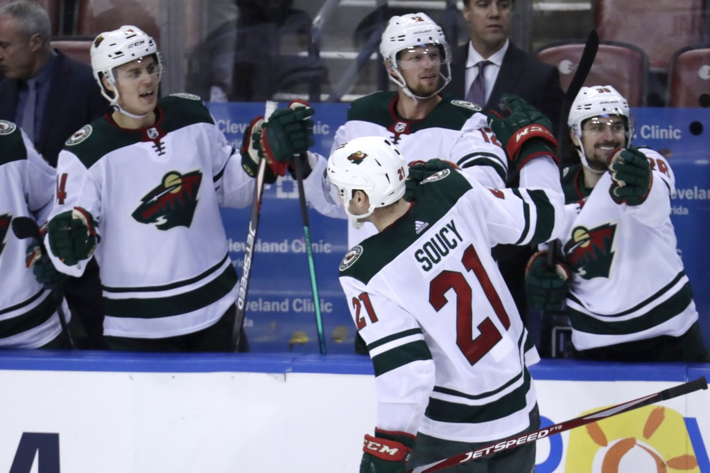 Minnesota Wild defenseman Carson Soucy (21) is congratulated after scoring a goal during the third period of an NHL hockey game against the Florida Pa...