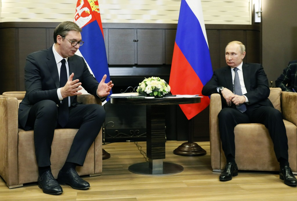 Russian President VladimirPutin, right, listens to Serbian President Aleksandar Vucic during their meeting at the Bocharov Ruchei residence in the Bl...