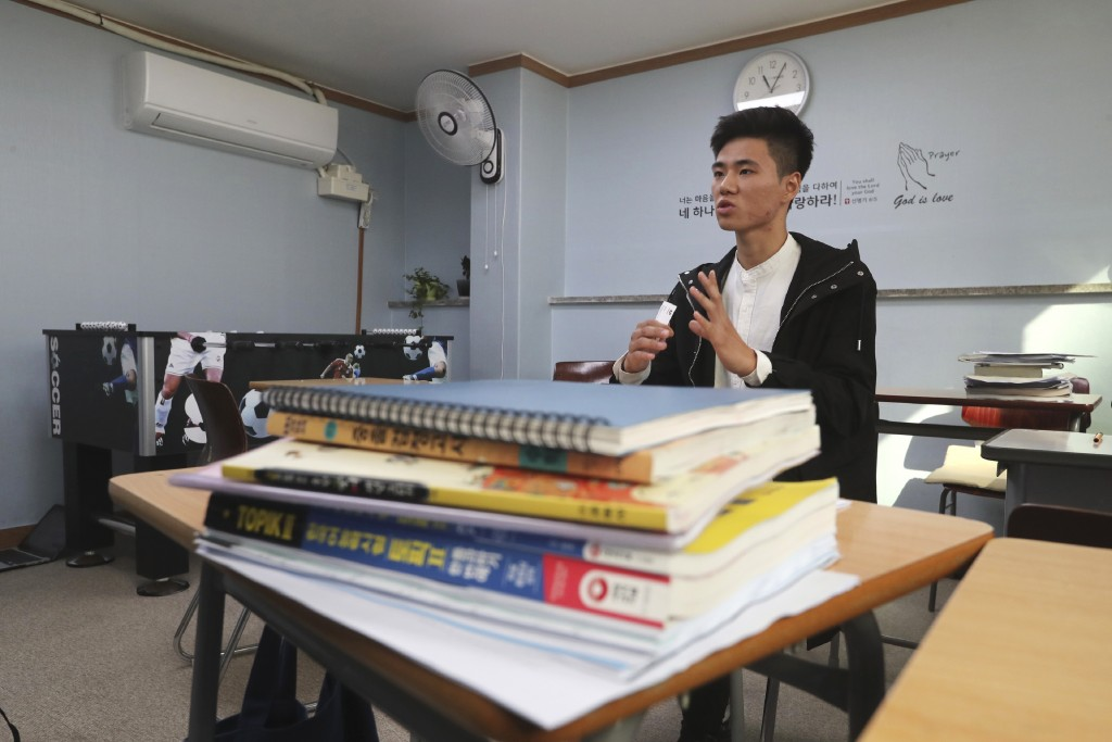 In this Nov. 1, 2019, photo, Kim Hyun-seung from Tianjin, China, 20, speaks during an interview at the South-North Love School in Seoul, South Korea. ...