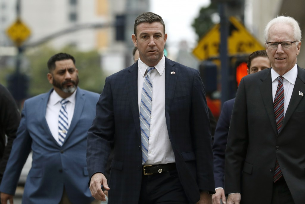 California Republican Rep. Duncan Hunter, center, walks towards federal court Tuesday, Dec. 3, 2019, in San Diego. Hunter said in a TV interview that ...