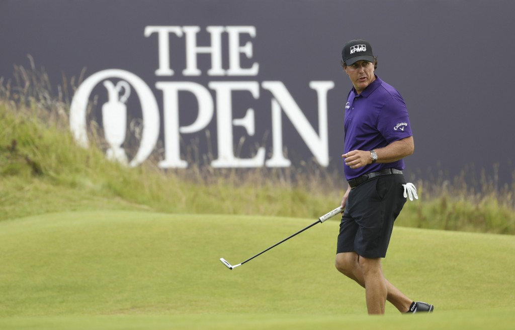 FILE - In this July 16, 2019, file photo, Phil Mickelson walks on the 18th green during a practice round ahead of the start of the British Open golf c...