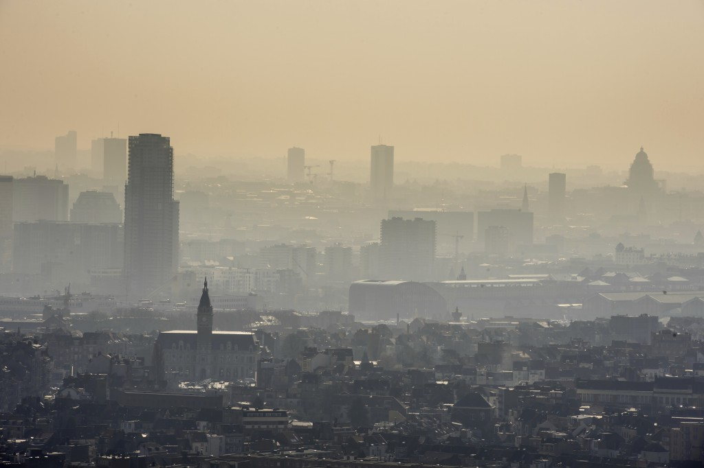 FILE - In this March 14, 2014 file photo a layer of smog covers the city of Brussels. The European Union says it will miss its targets for reducing pl...