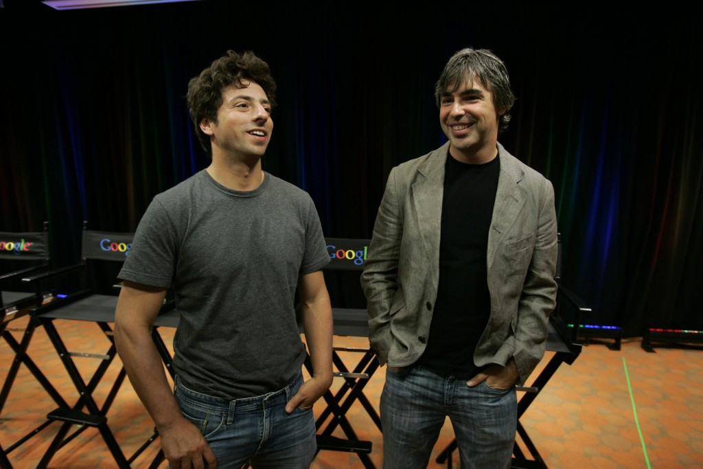 "FILE - In this Sept. 2, 2008, file photo Google co-founders Sergey Brin, left, and Larry Page talk about the new Google Browser, ""Chrome,"" during a ne..."