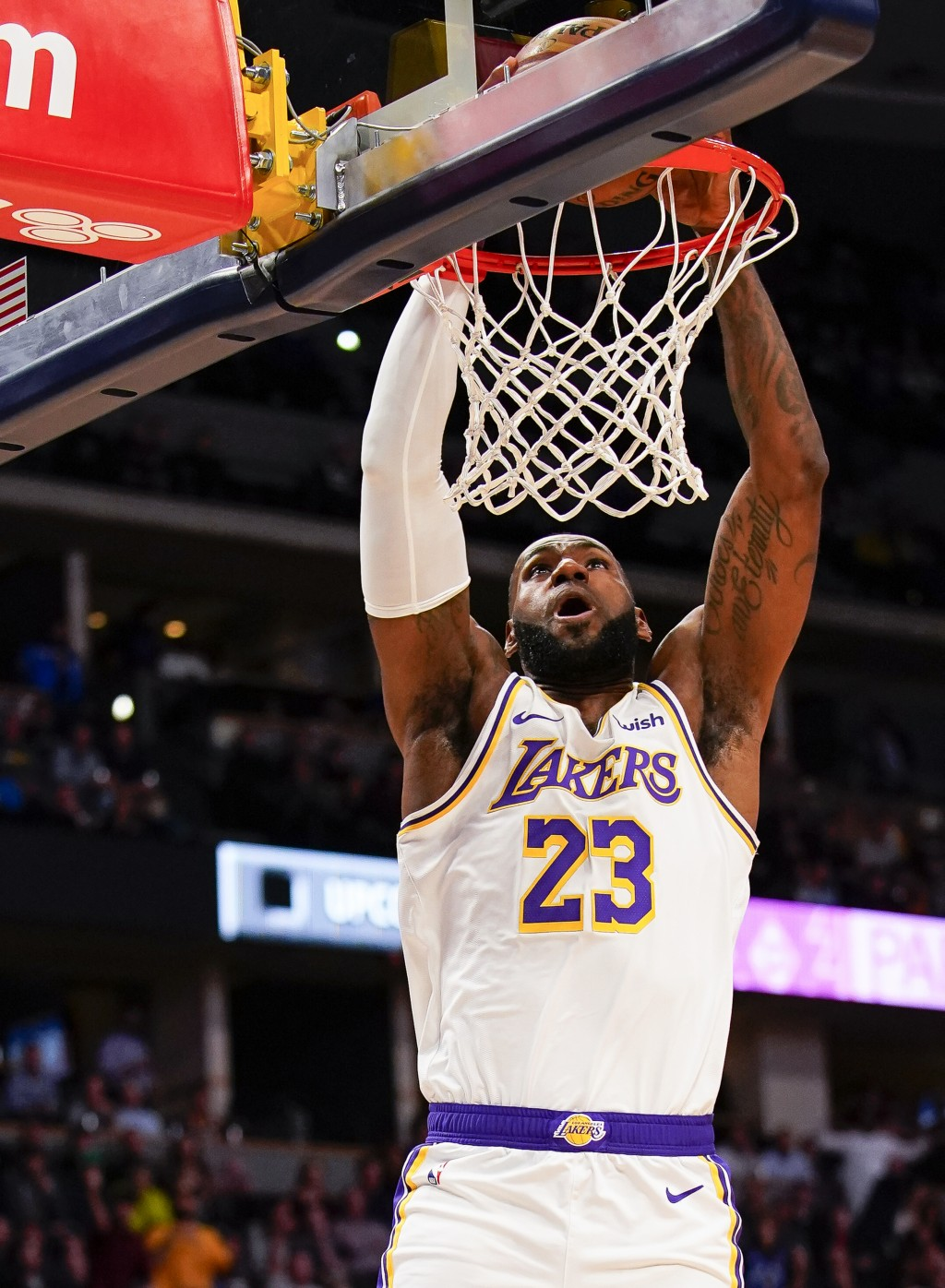 Los Angeles Lakers forward LeBron James dunks against the Denver Nuggets during the first quarter an NBA basketball game Tuesday, Dec. 3, 2019, in Den...