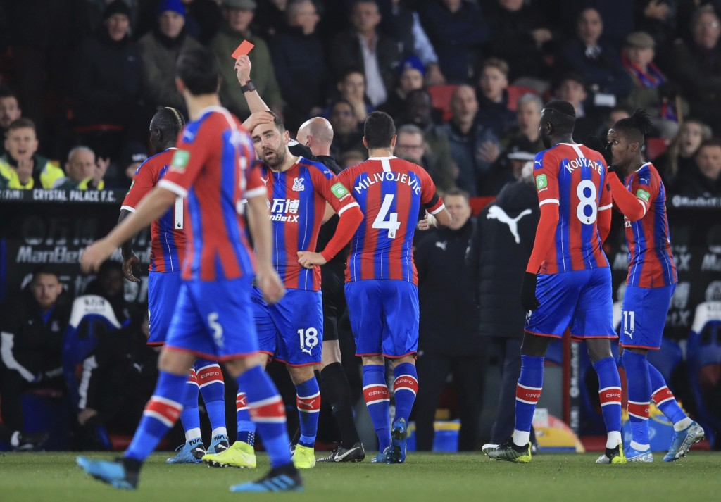 Crystal Palace's Mamadou Sakho, obscured, is sent off during the match against Bournemouth during their English Premier League soccer match at Selhurs...