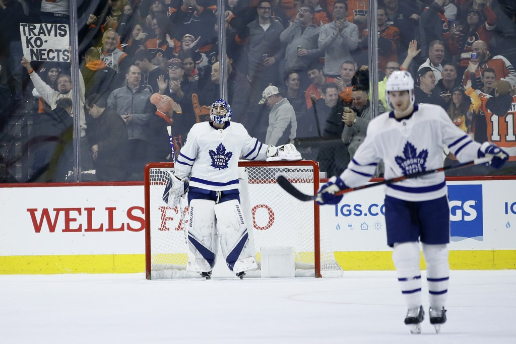 Toronto Maple Leafs' Frederik Andersen, center, reacts after giving up a goal to Philadelphia Flyers' Travis Konecny during the third period of an NHL...