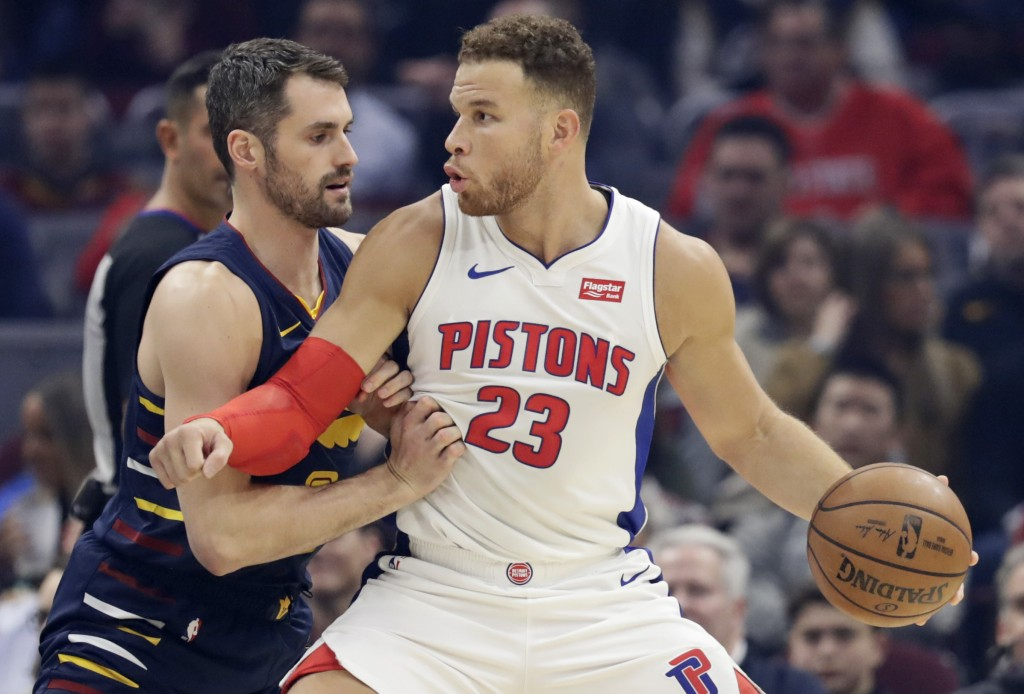 Detroit Pistons' Blake Griffin, right, drives past Cleveland Cavaliers' Kevin Love in the first half of an NBA basketball game, Tuesday, Dec. 3, 2019,...