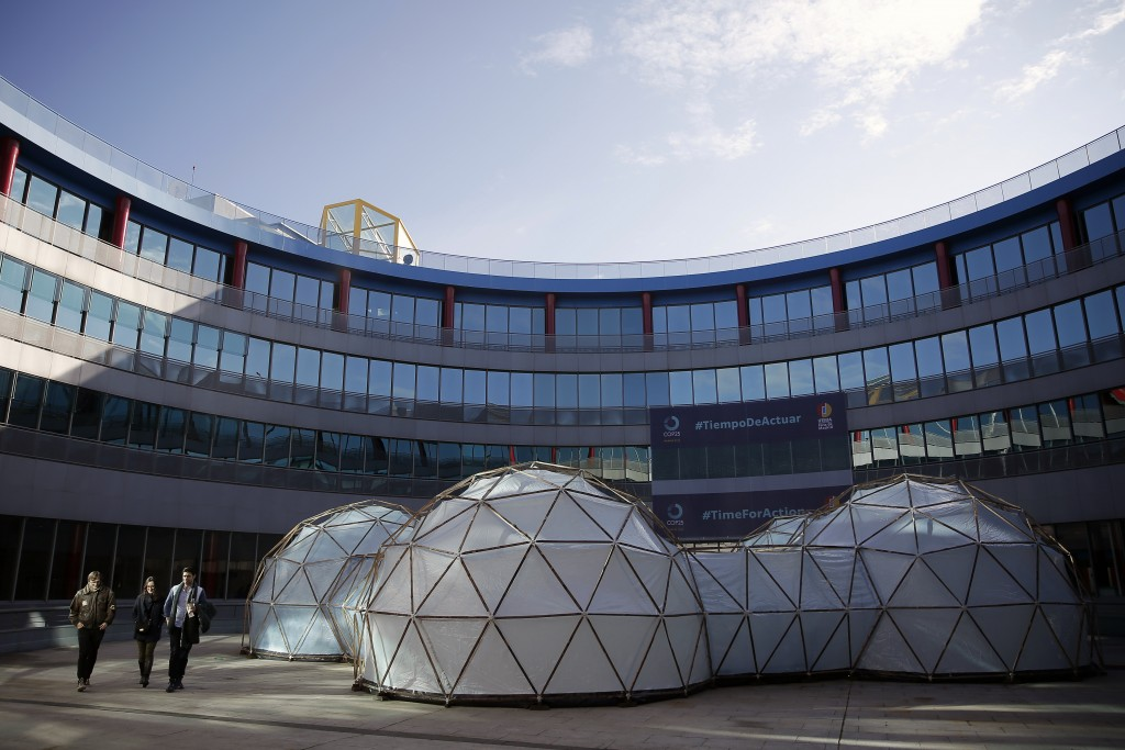 A pollution pod by British artist Michael Pinsky is displayed at the COP25 climate talks summit in Madrid, Spain, Tuesday, Dec. 3, 2019. The chair of ...