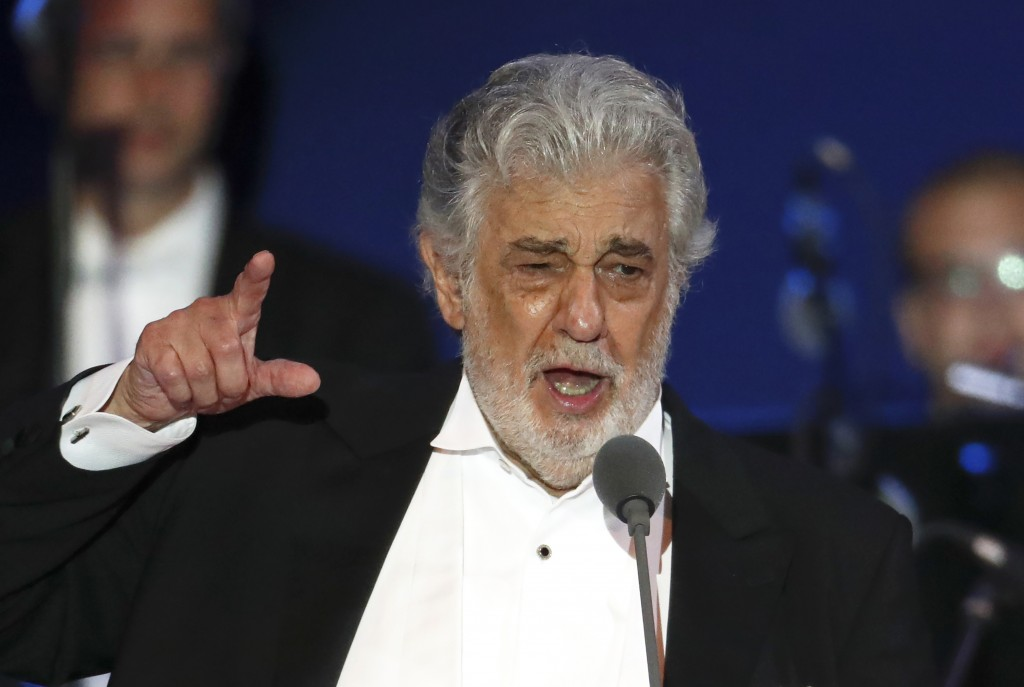 FILE- In this Aug. 28, 2019, file photo, opera singer Placido Domingo performs during a concert in Szeged, Hungary.  In an interview published Wednesd...