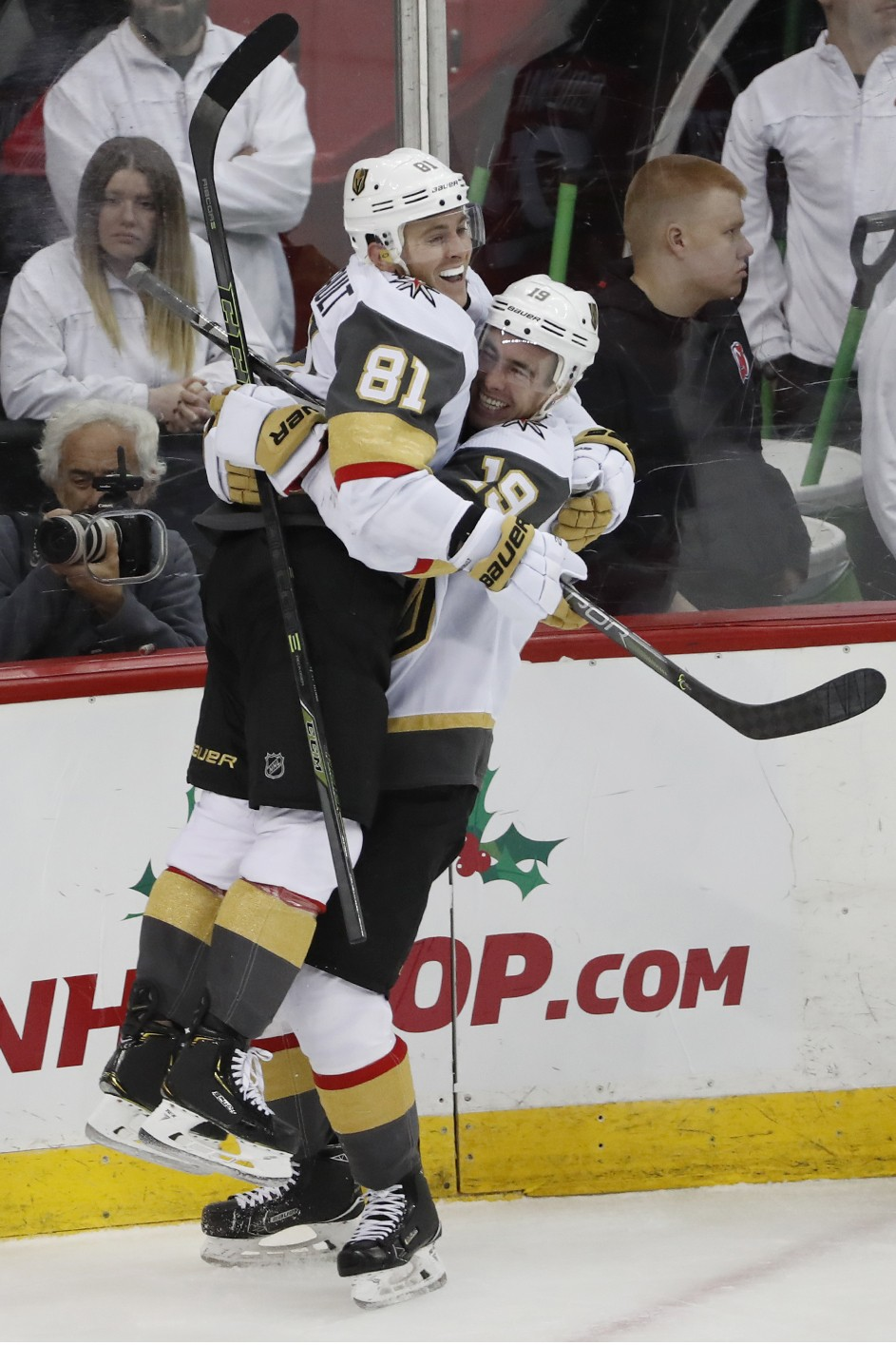 Vegas Golden Knights right wing Reilly Smith (19) lifts center Jonathan Marchessault (81) in the air after Marchessault scored his third goal of the n...