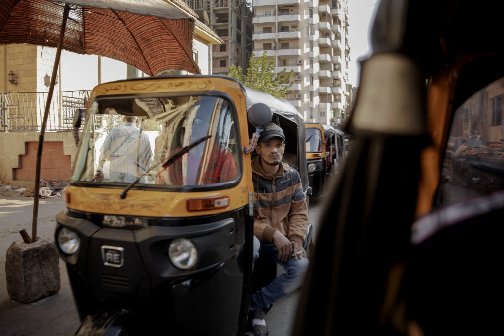 In this Nov. 19, 2019 photo, tuk-tuk drivers make their way with passengers on a street in Cairo, Egypt. Motorized rickshaws known as tuk-tuks have ru...
