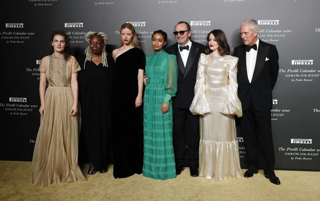 From left, Stella Roversi, American actress Whoopi Goldberg, British model Mia Goth, American model Yara Shahidi, Italian photographer Paolo Roversi, ...