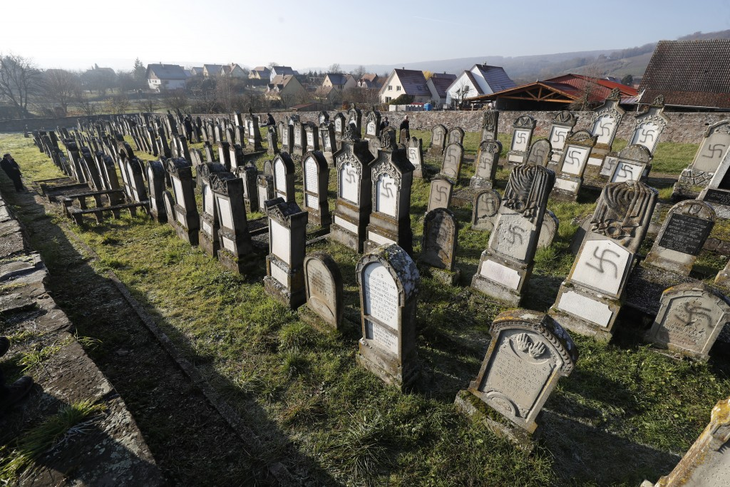 Vandalized tombs are pictured in the Jewish cemetery of Westhoffen, west of the city of Strasbourg, eastern France, Wednesday, Dec. 4, 2019. Regional ...