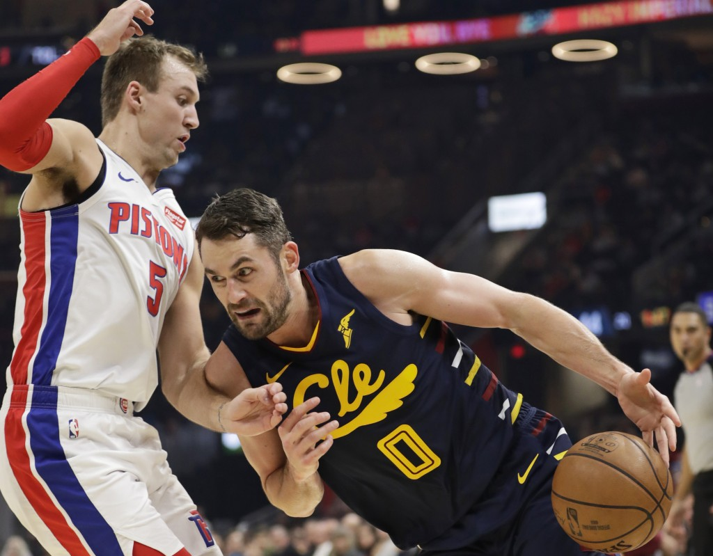 Cleveland Cavaliers' Kevin Love (0) drives to the basket against Detroit Pistons' Luke Kennard (5) in the first half of an NBA basketball game, Tuesda...