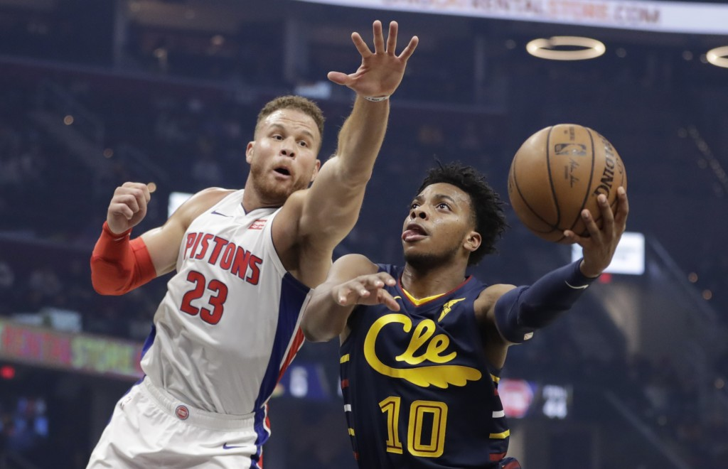 Cleveland Cavaliers' Darius Garland (10) drives to the basket against Detroit Pistons' Blake Griffin (23) in the first half of an NBA basketball game,...