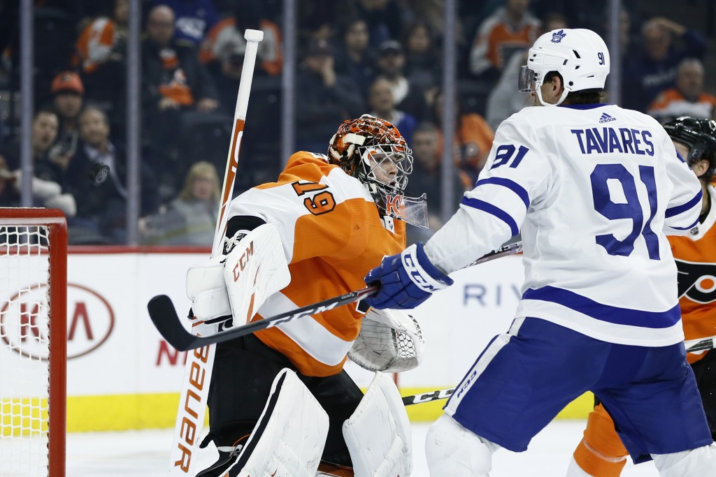 Philadelphia Flyers' Carter Hart, left, cannot stop a goal by Toronto Maple Leafs' Travis Dermott as John Tavares, right, looks on during the third pe...