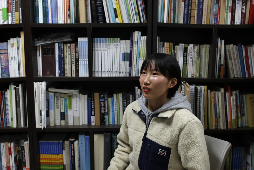 In this Nov. 6, 2019, photo, Song Hong Ryon speaks during an interview in Uijeongbu, South Korea. Song Hong Ryon looks like any other young woman in S...
