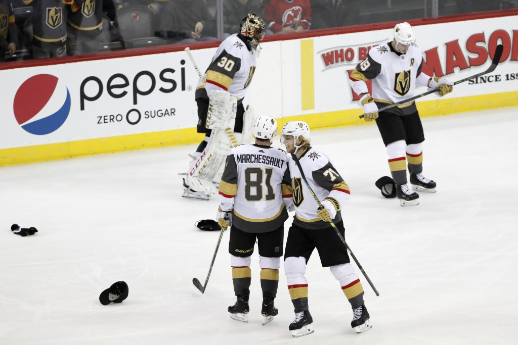 Vegas Golden Knights center William Karlsson (71) congratulates center Jonathan Marchessault (81) as goaltender Malcolm Subban (30) and right wing Rei...