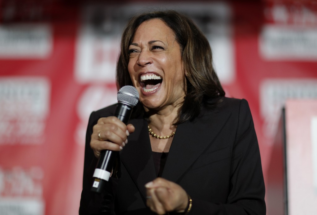 FILE - In this Nov. 8, 2019, file photo, then-Democratic presidential candidate Sen. Kamala Harris, D-Calif., reacts as she speaks at a town hall even...