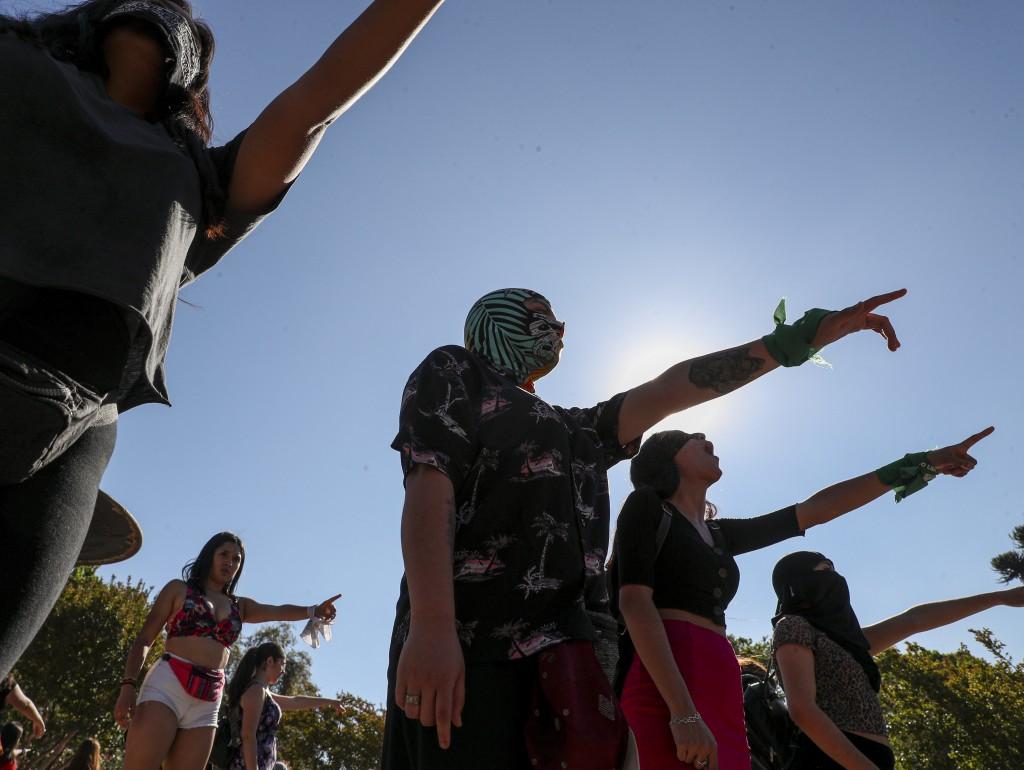 "Women perform, ""Un violador en tu camino"" or ""A rapist in your path,""  in a demonstration against gender-based violence, in San Bernardo, Chile, Tuesd..."