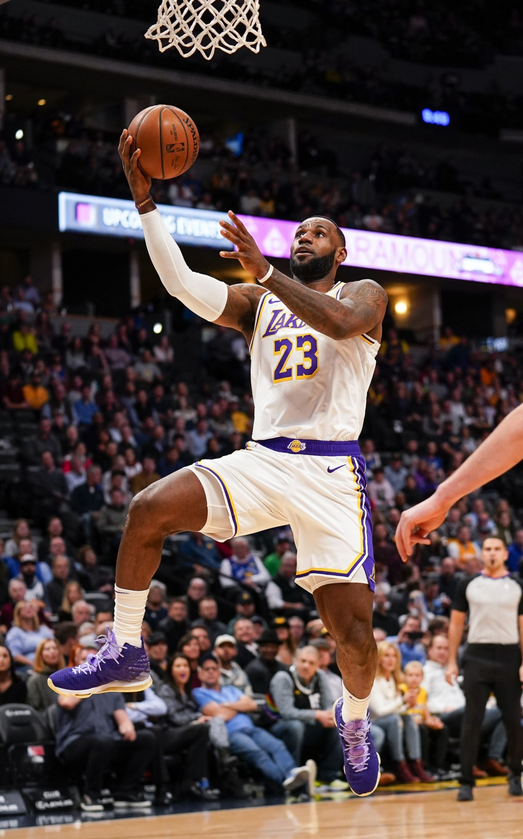 Los Angeles Lakers forward LeBron James goes up for a shot against the Denver Nuggets during the first quarter an NBA basketball game Tuesday, Dec. 3,...