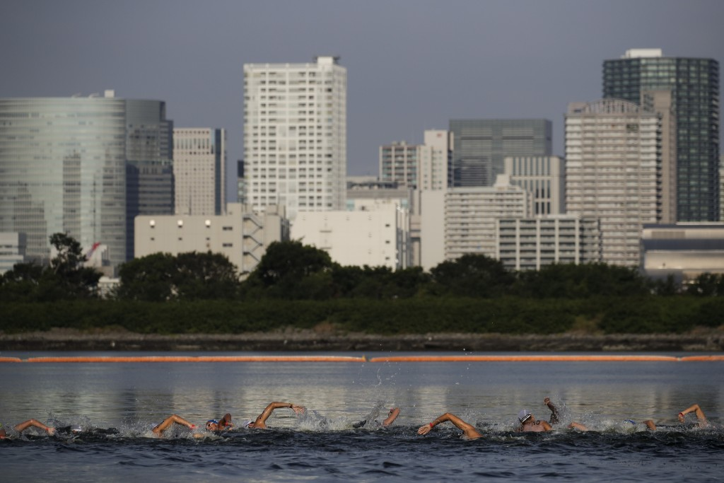 FILE - In this Aug. 11, 2019, file photo, athletes compete in a marathon swimming test event at Odaiba Marine Park, a venue for marathon swimming and ...