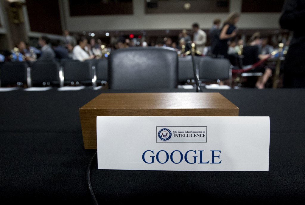 FILE - In this Sept. 5, 2018, file photo, an empty chair reserved for Google's parent Alphabet, which refused to send its top executive, is seen befor...