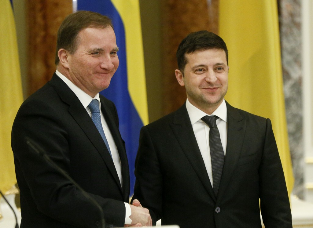 Ukrainian President Volodymyr Zelenskiy, right, welcomes Sweden's Prime Minister Stefan Lofven during their meeting in Kyiv, Ukraine, Wednesday, Dec. ...