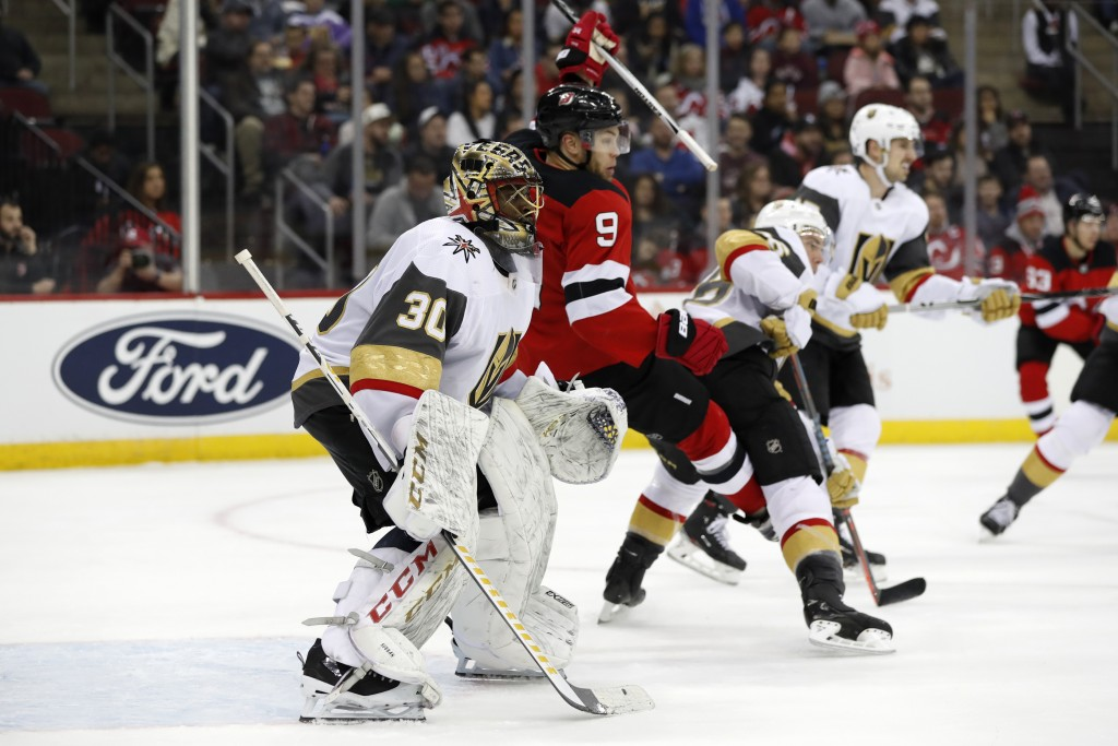 New Jersey Devils left wing Taylor Hall (9) trips in front of Vegas Golden Knights goaltender Malcolm Subban (30) during the second period of an NHL h...