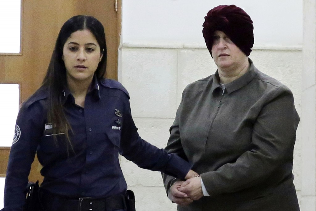 FILE - This Feb. 27, 2018 file photo, Australian Malka Leifer, right, is brought to a courtroom in Jerusalem. Leifer is wanted in Australia for 74 cha...