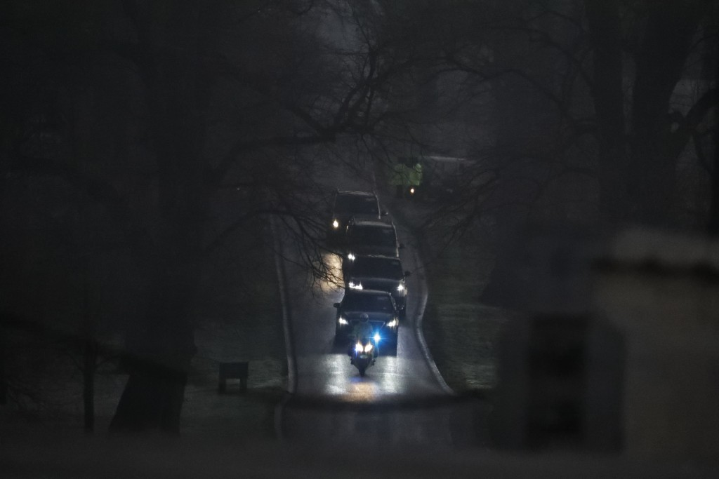 A convoy is arriving for a NATO leaders meeting at The Grove hotel and resort in Watford, Hertfordshire, England, Wednesday, Dec. 4, 2019. As NATO lea...