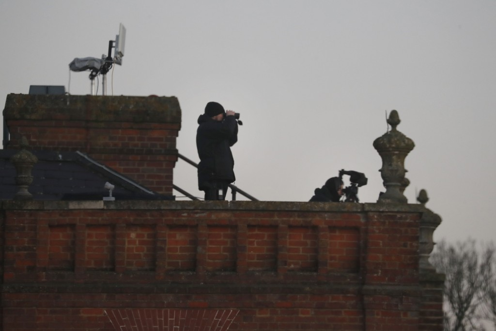 Security forces are positioned on the roof of the Grove hotel and resort where NATO leaders are meeting in Watford, Hertfordshire, England, Wednesday,...