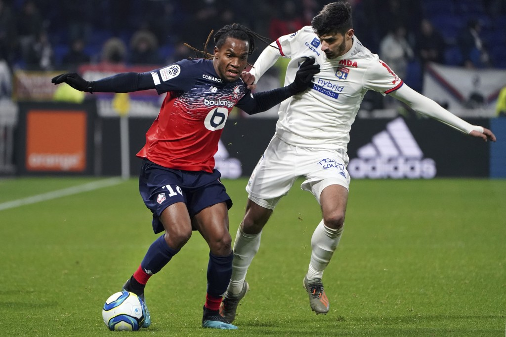 Lille's Renato Luz Sanches, left, challenges with Lyon's Martin Terrier, during the French League One soccer match between Lyon and Lille in Decines, ...