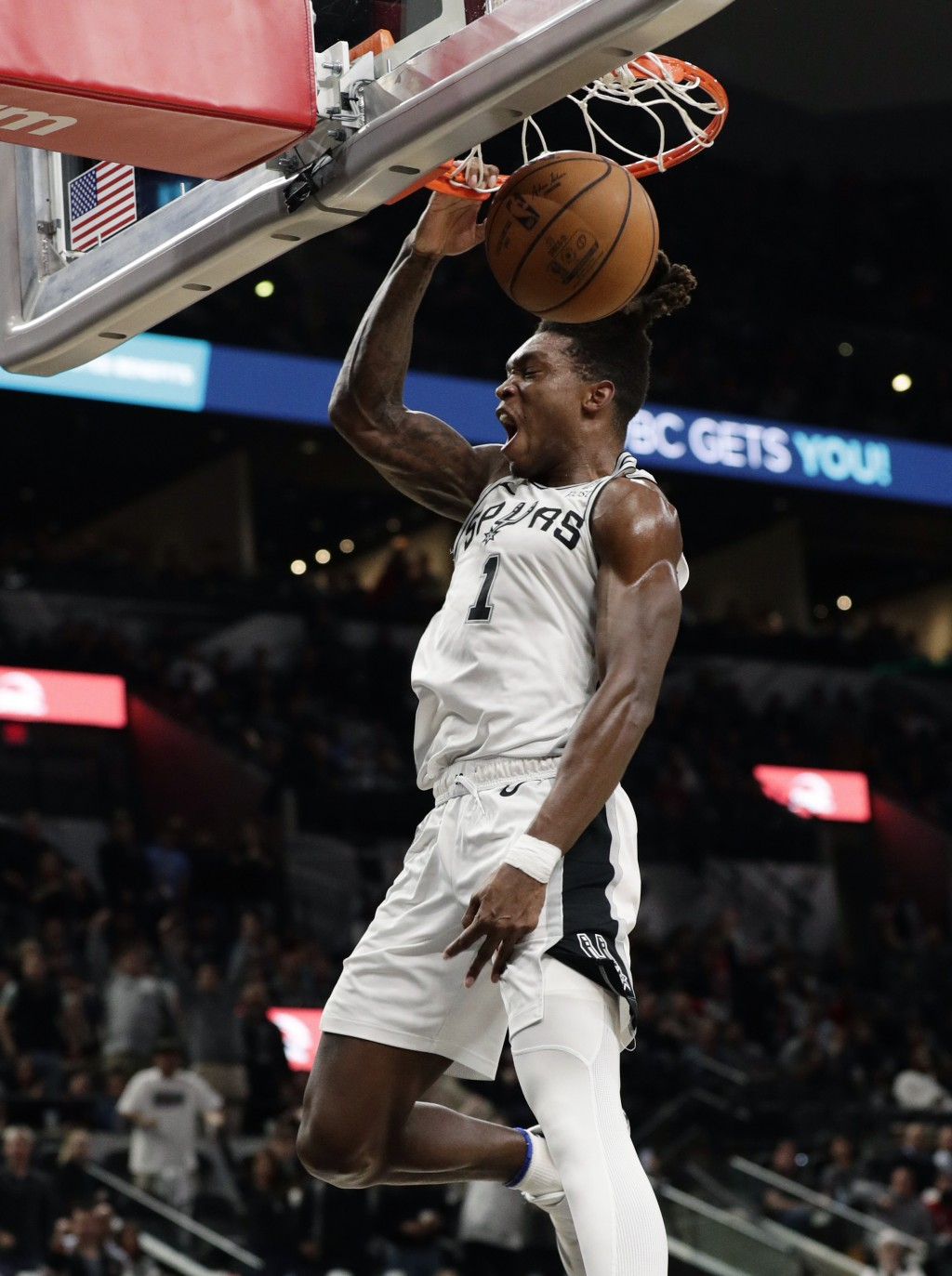 San Antonio Spurs guard Lonnie Walker IV dunks against the Houston Rockets during the second half of an NBA basketball game in San Antonio, Tuesday, D...