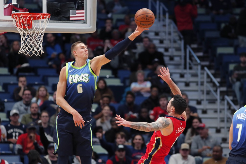 Dallas Mavericks forward Kristaps Porzingis (6) blocks a shot by New Orleans Pelicans guard JJ Redick in the first half of an NBA basketball game in N...