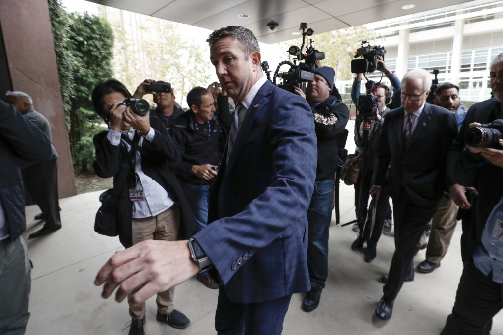 California Republican Rep. Duncan Hunter reaches to open the door to federal court Tuesday, Dec. 3, 2019, in San Diego. Hunter said in a TV interview ...