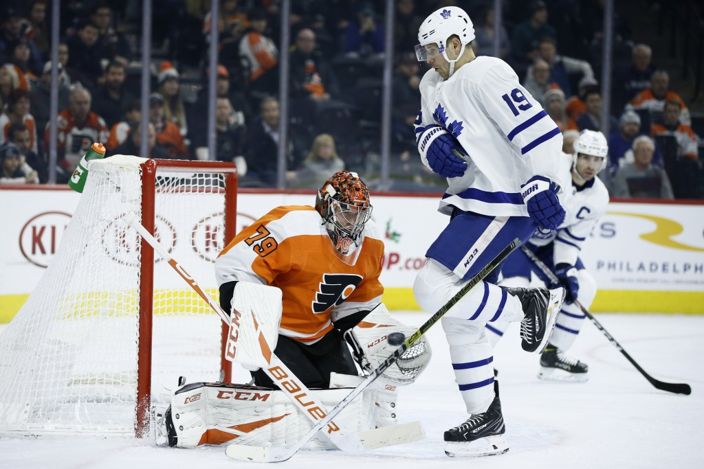 Philadelphia Flyers' Carter Hart (79) blocks a shot as Toronto Maple Leafs' Jason Spezza (19) screens during the first period of an NHL hockey game, T...