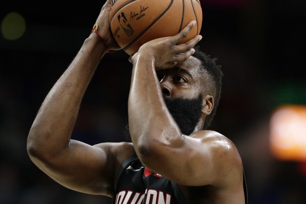 Houston Rockets guard James Harden shoots a free throw during the first half of the team's NBA basketball game against the San Antonio Spurs in San An...