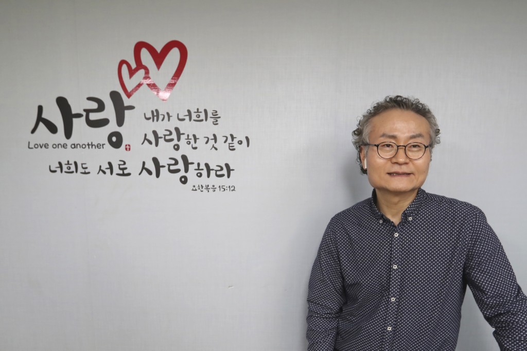 In this Nov. 1, 2019, photo, Shim Yang-sup, the principal of the Seoul-based alternative South-North Love School, speaks during an interview at his sc...